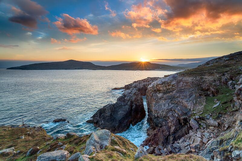 Dramatic sunset over the cliffs at Hushinish stock images