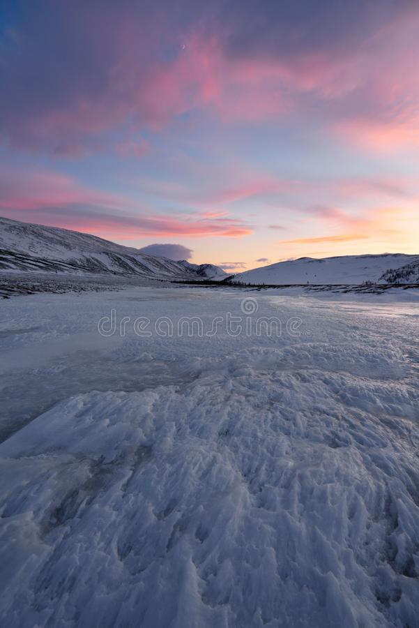 Dramatic sunset over the icy lake in the Arctic tundra. Yamal peninsula. Russia royalty free stock photography