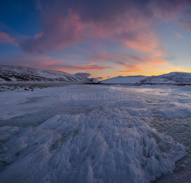 Dramatic sunset over the icy lake in the Arctic tundra. Yamal peninsula. Russia stock photos