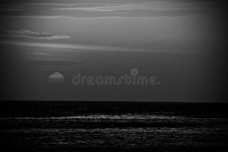 Dramatic sunset over the Pacific ocean stock photo