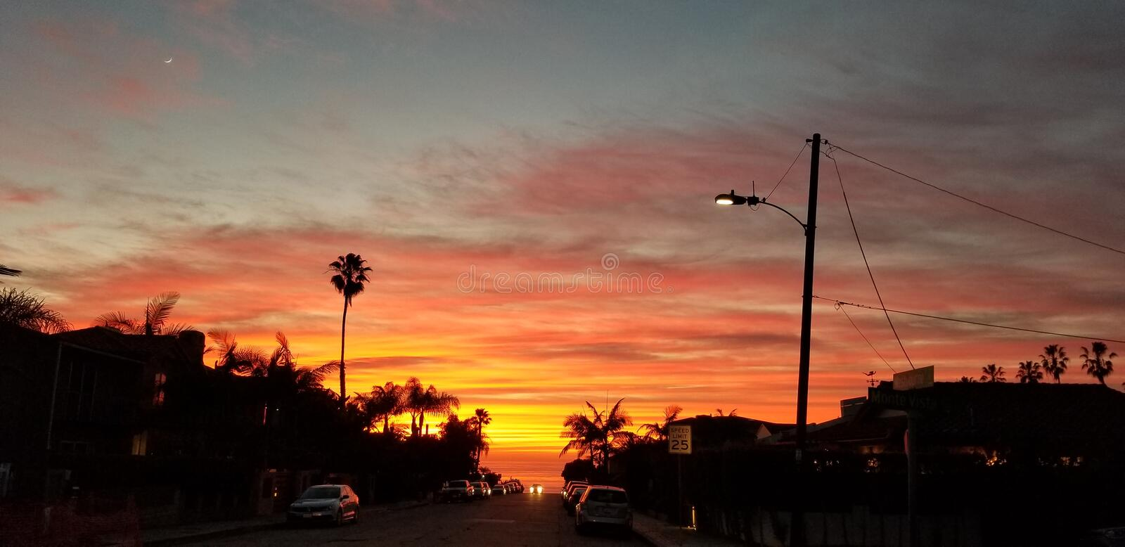 Dramatic Sunset over Pacific Ocean - Street view with Palms stock photos