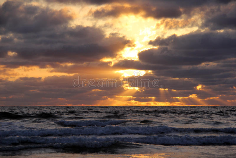 Dramatic Sunset Over Pacific Waves royalty free stock images