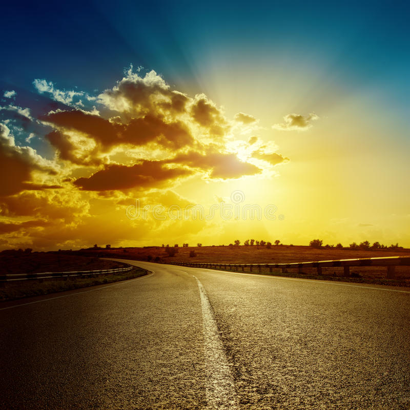 Dramatic sunset over road royalty free stock photography