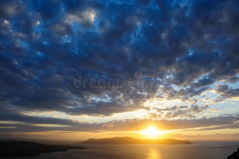 Dramatic sunset over Santorini caldera sea royalty free stock photos