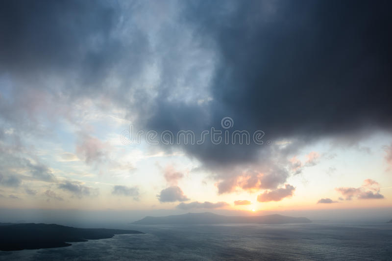 Dramatic sunset over Santorini caldera sea stock image