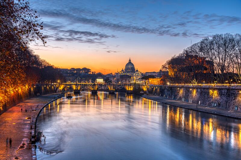 Dramatic sunset over the St. Peters Basilica royalty free stock photography