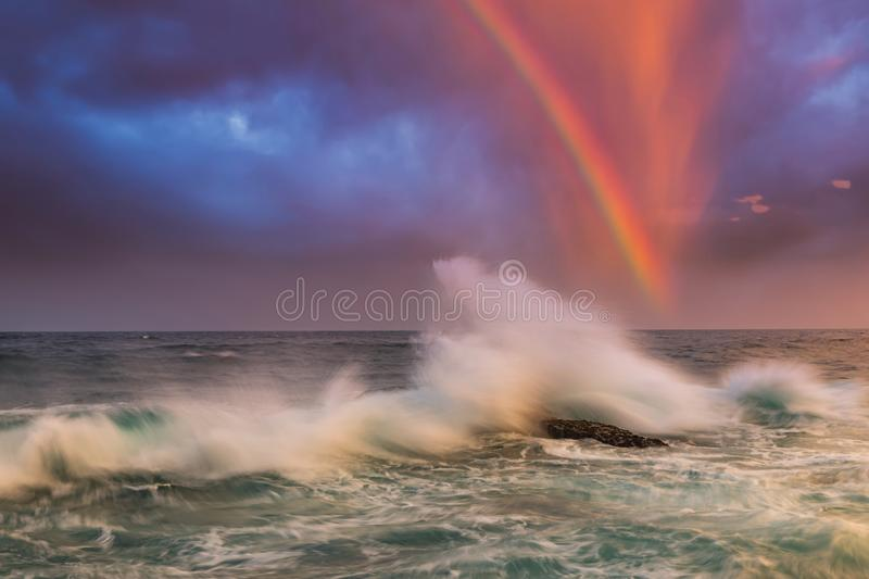 Dramatic sunset over the stormy sea. Summer vacation on tropical resort. stock image