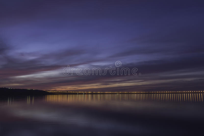 Dramatic sunset over Volga River and Presidental Bridge, located in Ulyanovsk royalty free stock photo