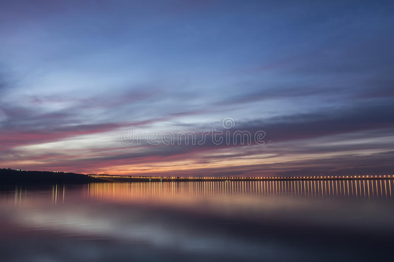 Dramatic sunset over Volga River and Presidental Bridge, located in Ulyanovsk, Russia royalty free stock photography