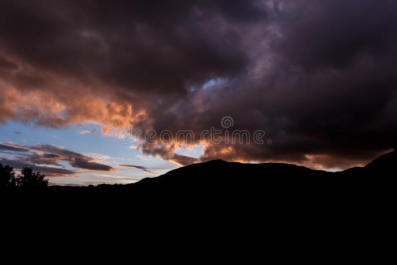 Sunset over a hill stock photography