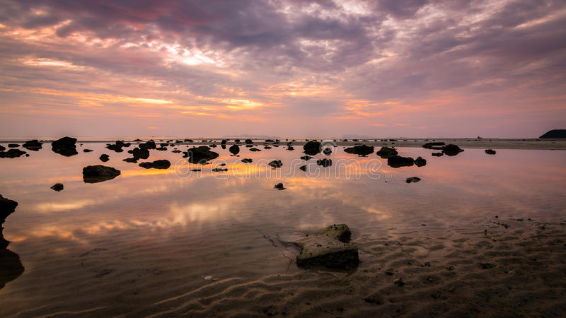 Dramatic sunset with reflect sky in the water royalty free stock photography