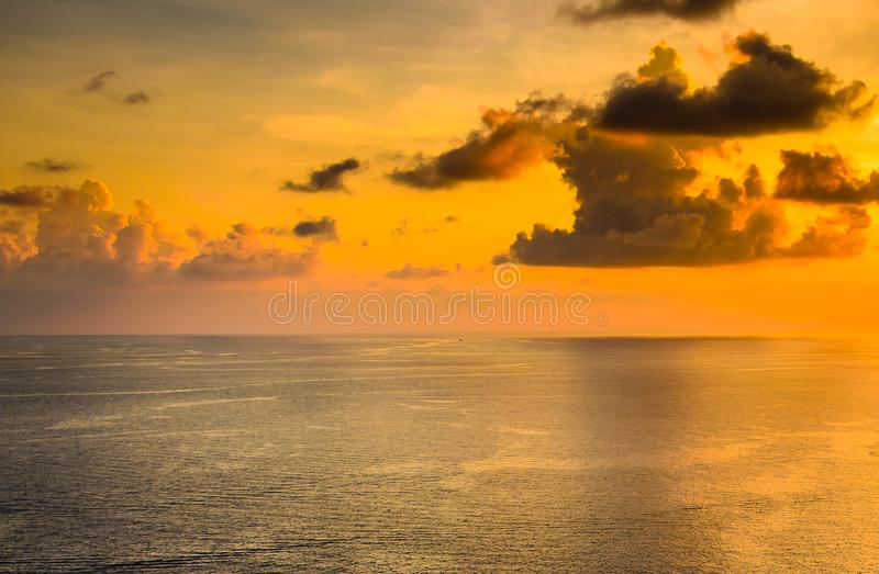 Dramatic sunset at sea with cloudy sky landscap photo background royalty free stock photos