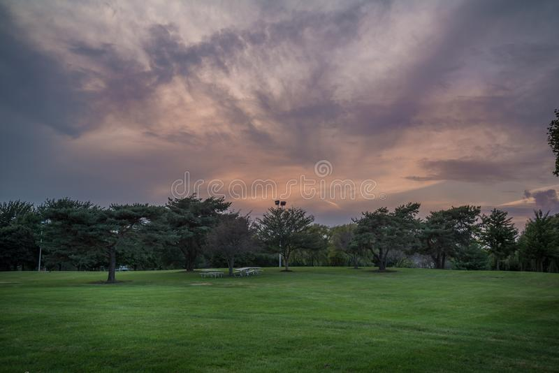Dramatic sunset skies. Over a park royalty free stock images