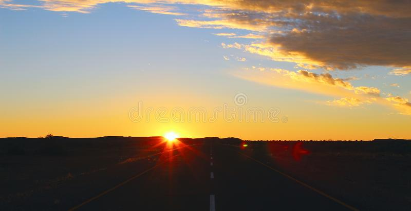 Sunset sky and road in the desert royalty free stock photos