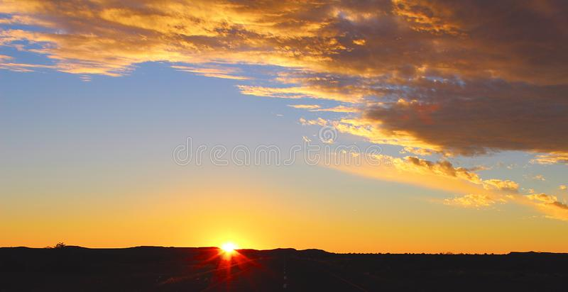Sunset sky and road in the desert royalty free stock photography