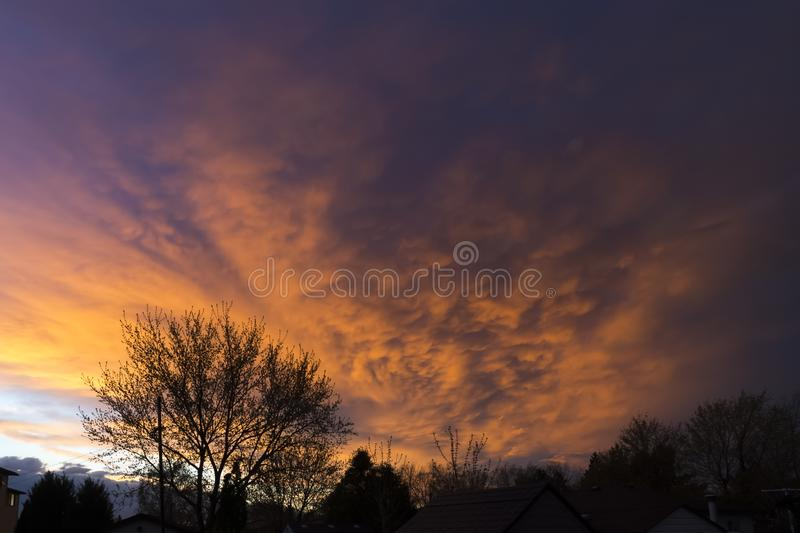 Dramatic sunset sky reflecting off of storm clouds approaching n royalty free stock photography