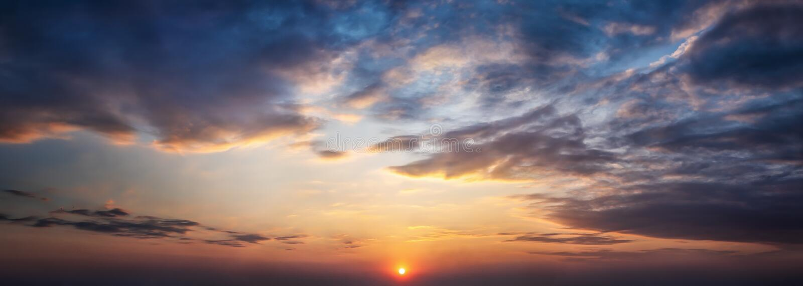 Dramatic sunset and sunrise sky. Orange and yellow colors sunset. Panoramic view. Dramatic sunset and sunrise sky. Orange, blue and yellow colors sunset royalty free stock images