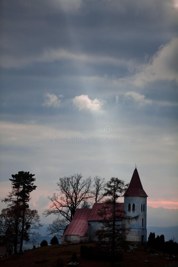 Rays of the sun from the sky - Church on the horizon royalty free stock images