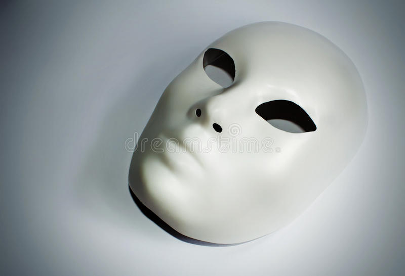 Dramatic theatre concept with the white mask royalty free stock images