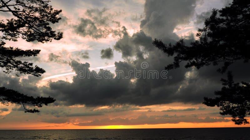 Dramatic thunder clouds at sunset sky royalty free stock photos
