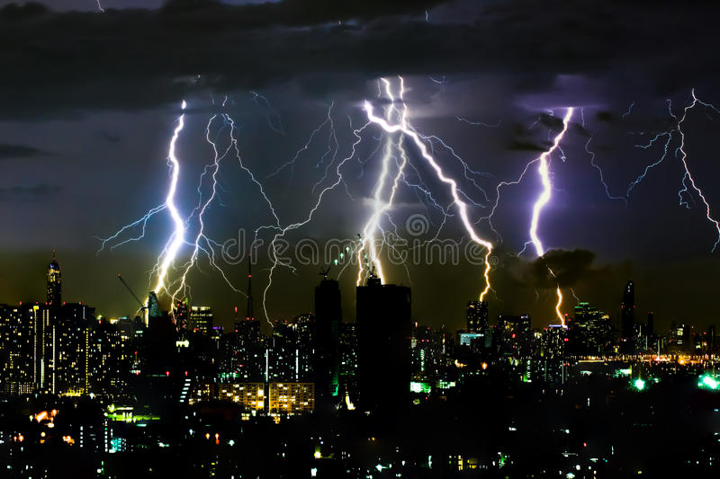 Dramatic thunder storm lightning bolt on the horizontal sky and city scape stock images