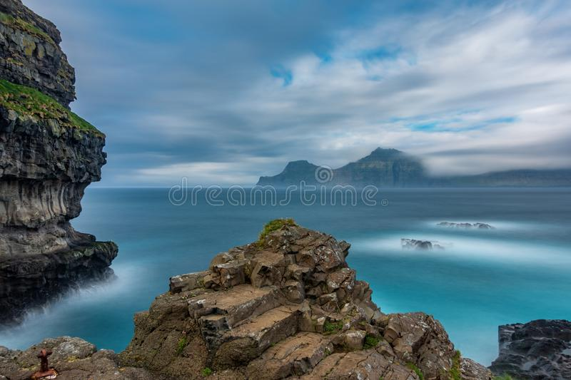Dramatic ultra long exposure of viewpoint over the ocean stock photography
