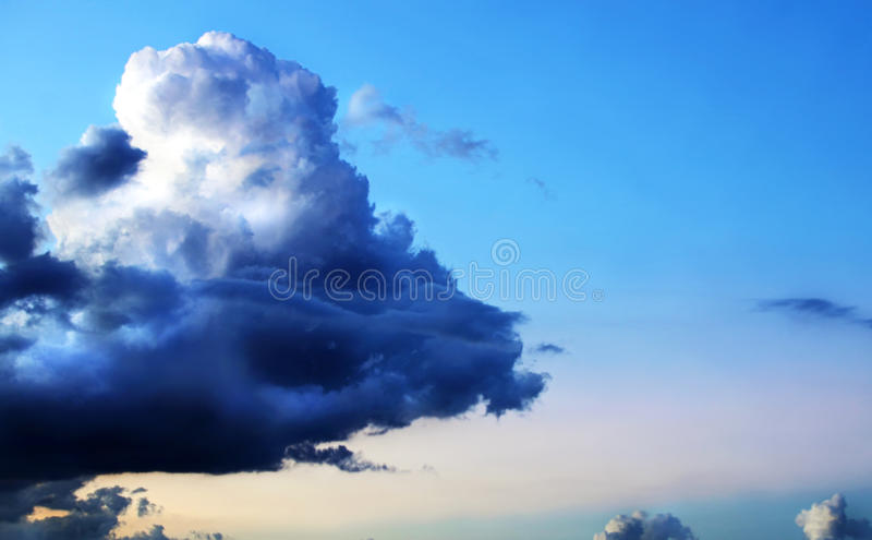 Dramatic unique storm cloud on beautiful blue sky royalty free stock images