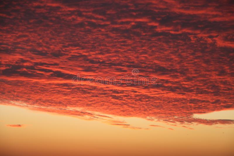 Dramatic Volcanic Crimson Sunset over Pacific Ocean royalty free stock photography