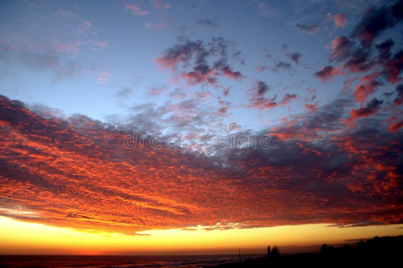 Dramatic Volcanic Crimson Sunset over Pacific Ocean stock images
