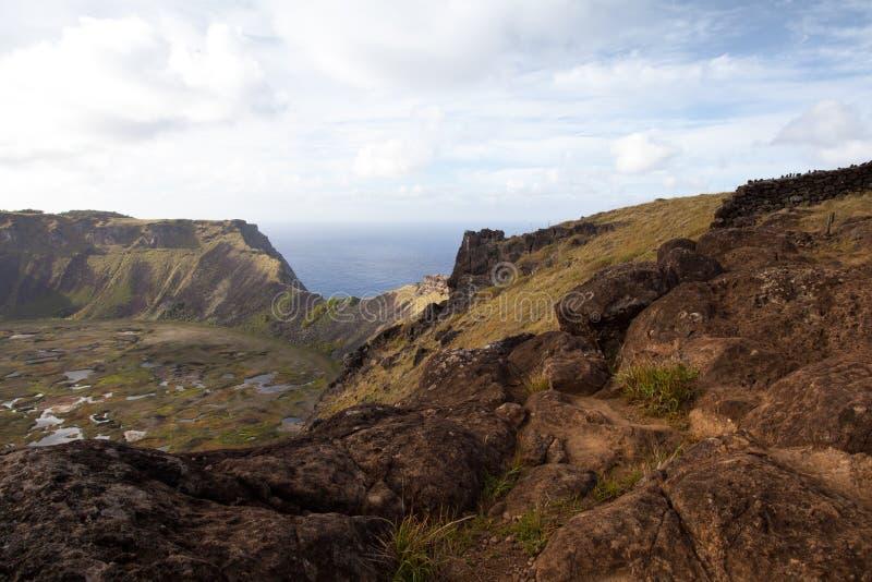 Dramatic Volcano crater near Orongo Easter Island. Dramatic Volcano crater near Orongo vilage, Easter Island, grassy walls, sharp rocks, endless ocean royalty free stock photos
