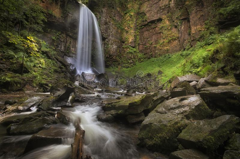 Waterfall and rocks at Melincourt. The dramatic waterfall at Melincourt Brook in Resolven, South Wales, UK royalty free stock photography