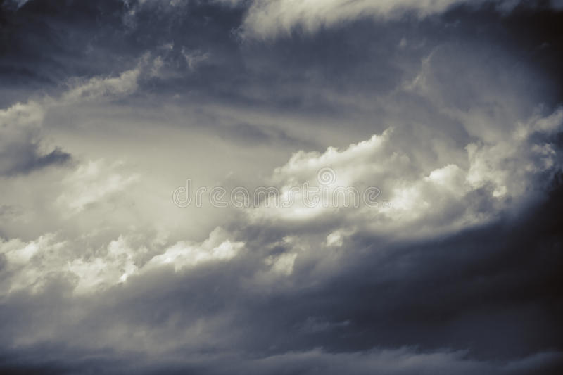 Dramatic winter cloudscape in bw background stock photo