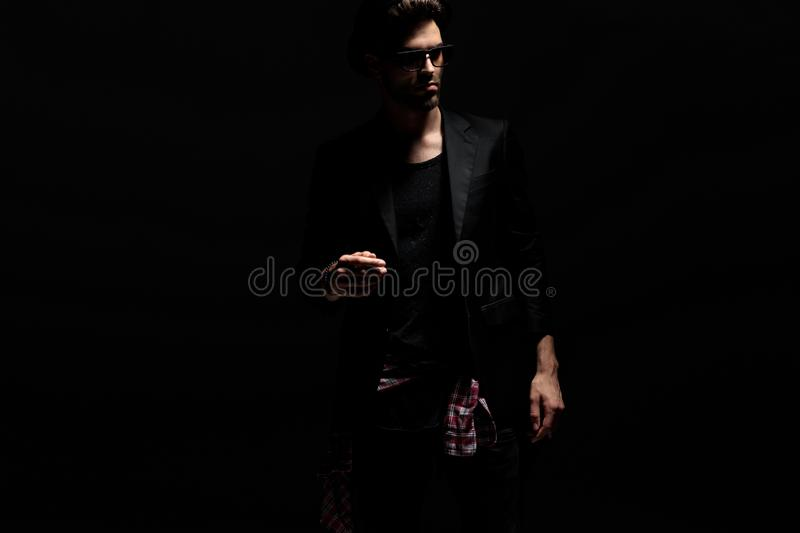 Dramatic young man walking and looking away stock image