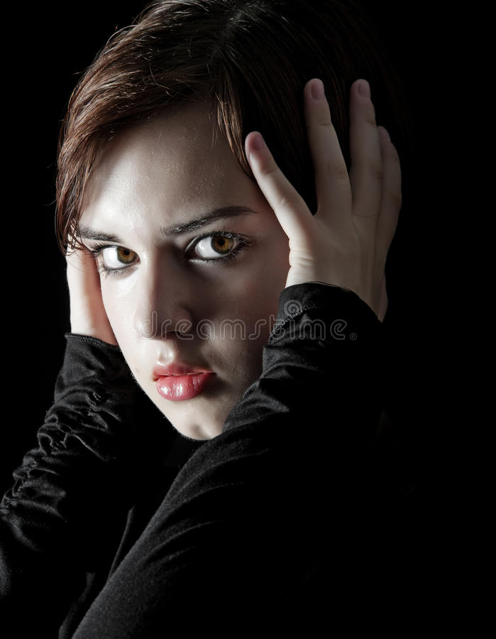 Dramatic young woman portrait stock photos