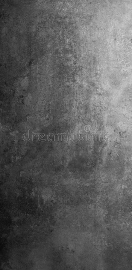 Grey and black stone vintage texture background. Dramaticly lighted grey and black vintage texture stone background useful for food photography and stillife royalty free stock photo