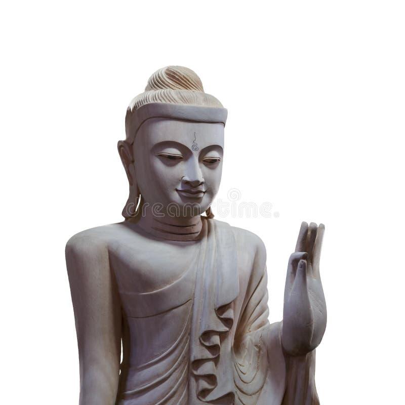 Dramatisk belysning wood buddha på isolerad vit bakgrund arkivfoton