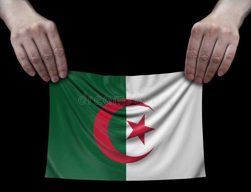 Drapeau algérien dans des mains photo libre de droits