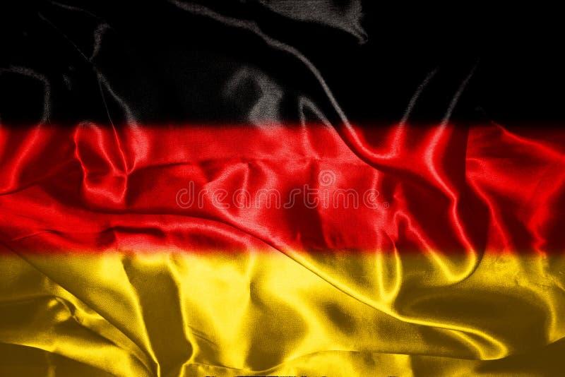 Drapeau allemand soufflant dans le vent illustration stock