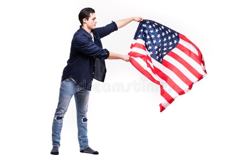 Drapeau américain des USA de vague de garçon photographie stock