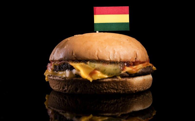 Drapeau bolivien sur l'hamburger d'isolement sur le noir images libres de droits