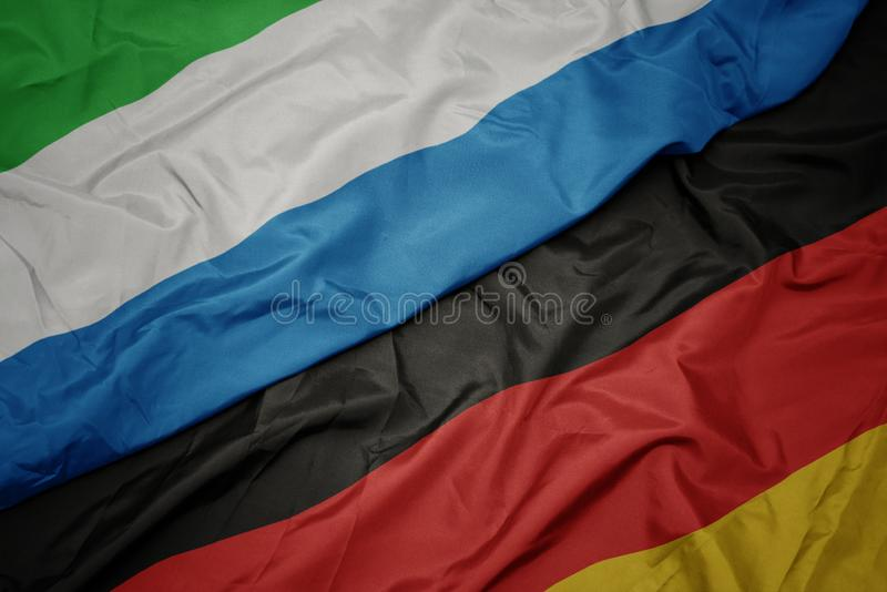 drapeau coloré de l' allemagne et drapeau national de la sierra leone photo stock