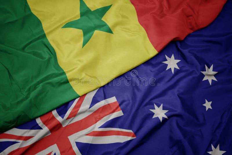 drapeau coloré de l' australie et drapeau national du sénégal images stock