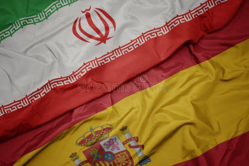 drapeau coloré de l' espagne et drapeau national de l' iran photographie stock
