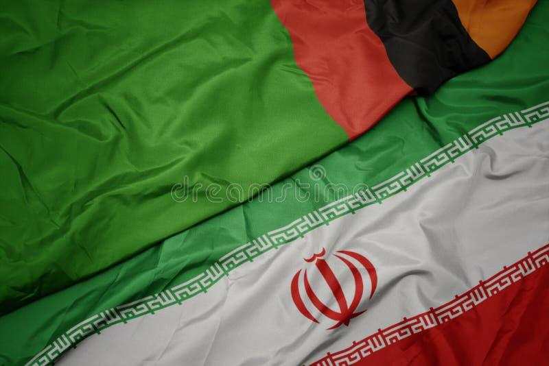 drapeau coloré de l' iran et drapeau national de la zambie photo stock