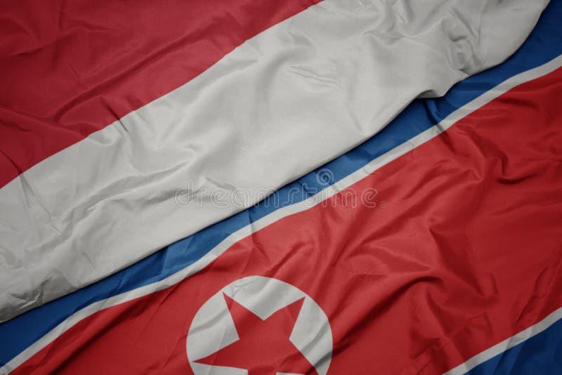 drapeau coloré de la corée du nord et drapeau national de l' indonésie photos stock