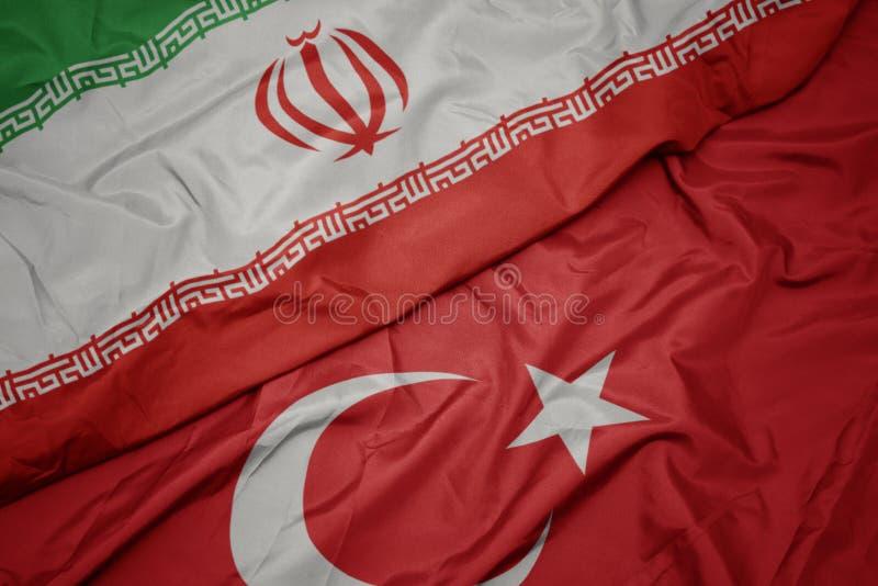 drapeau coloré de la dinde et drapeau national de l' iran photo libre de droits