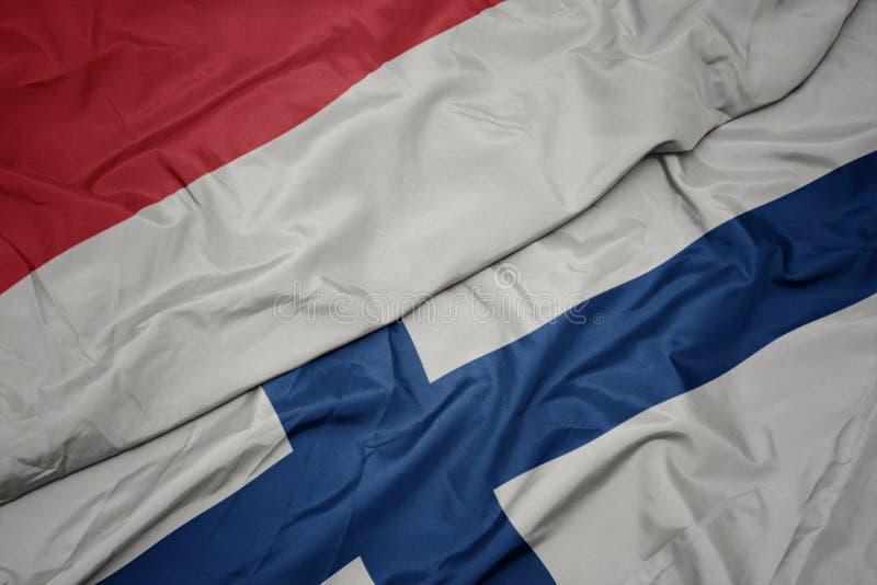 drapeau coloré de la finlande et drapeau national de l' indonésie images libres de droits