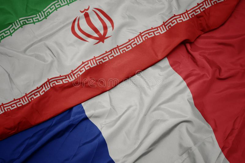 drapeau coloré de la france et drapeau national de l' iran image stock