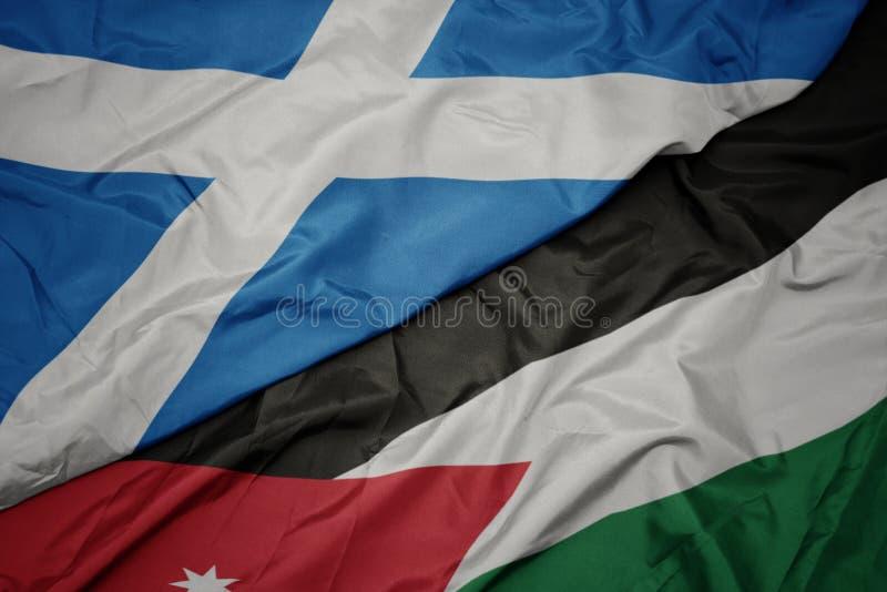 drapeau coloré de la jordan et drapeau national de l' écosse photo libre de droits