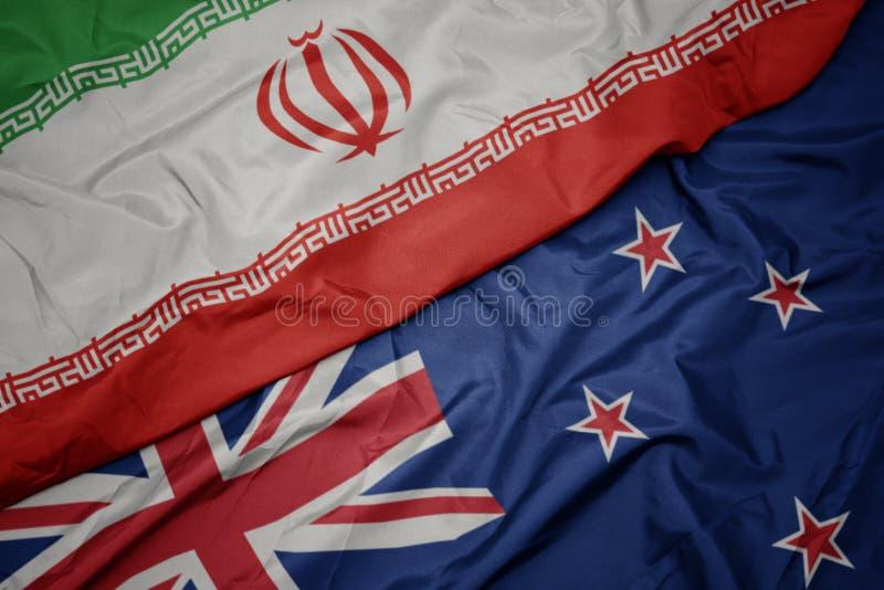 drapeau coloré de la nouvelle-zélande et drapeau national de l' iran photographie stock
